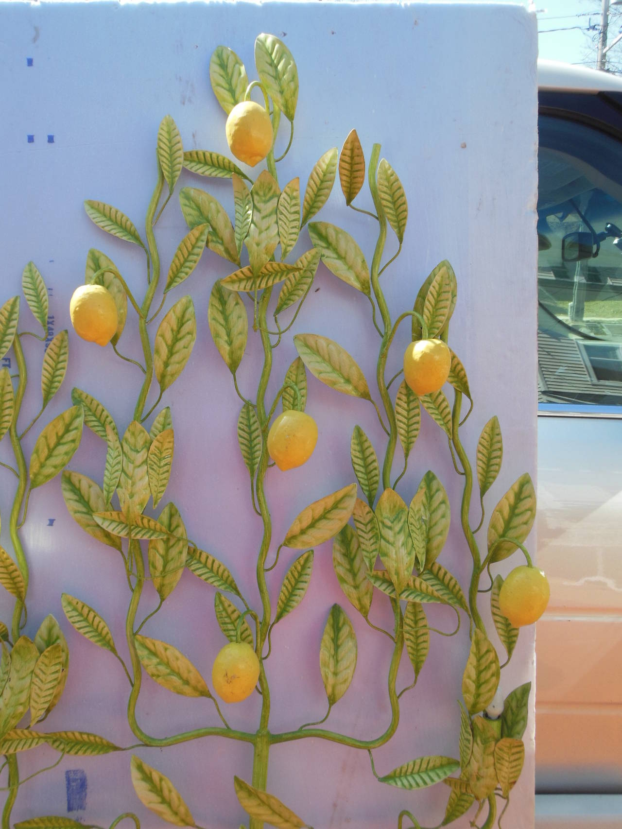 An Italian Tole Lemon Tree with original lights. This tree was much loved as the condition is excellent. Have not had a chance to check the wiring. The Italian Tole trees are becoming hard to find. The Lemon tree will be exhibited at the New York