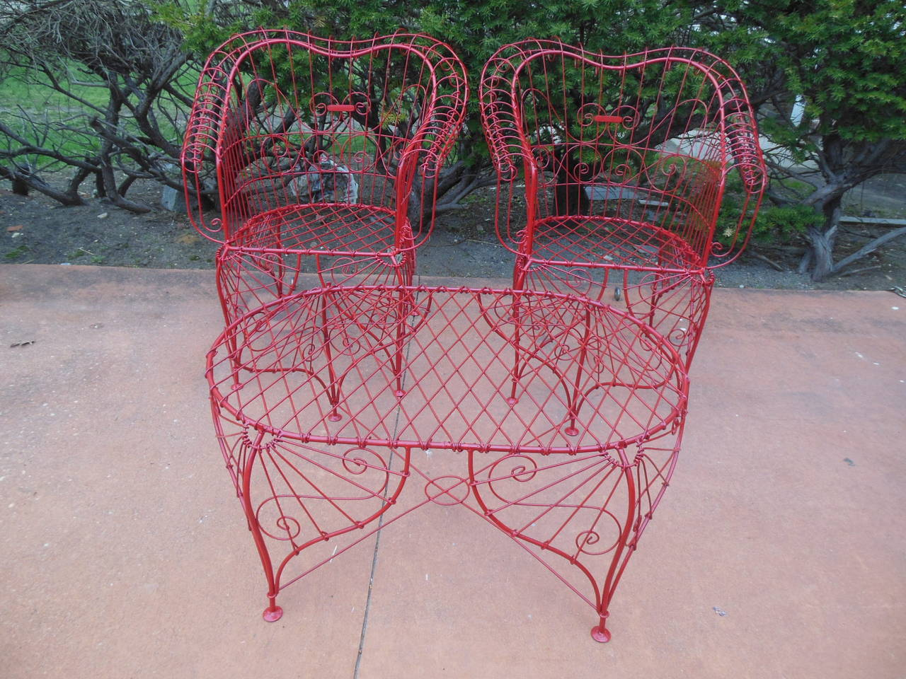 """This is a fun patio three-piece set. The chairs are large and comfortable and the coffee table is 37"""" long and 17"""" tall. The set is in excellent condition having just been painted a glossy red color. Let this set make your patio or"""