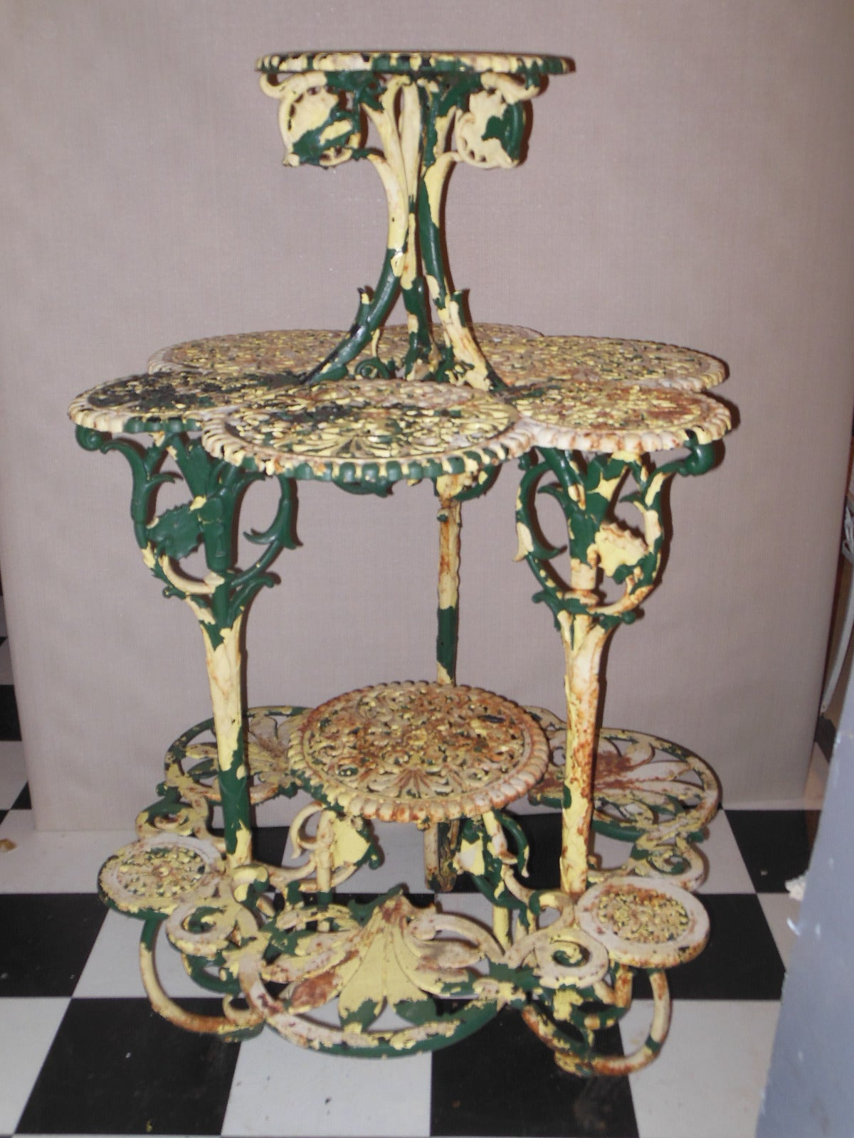 A cast iron circular four-tier plant stand strongly attributed to Coalbrookdale. The plant stand with details of vigorously carved leaves and pierced lacy circular tiered stands. The plant stand, from my personal collection when purchased over 20
