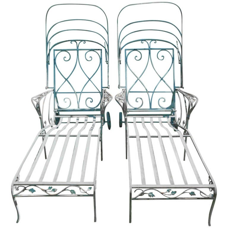 Pair of garden chaise lounges by salterini in wrought for Black wrought iron chaise lounge