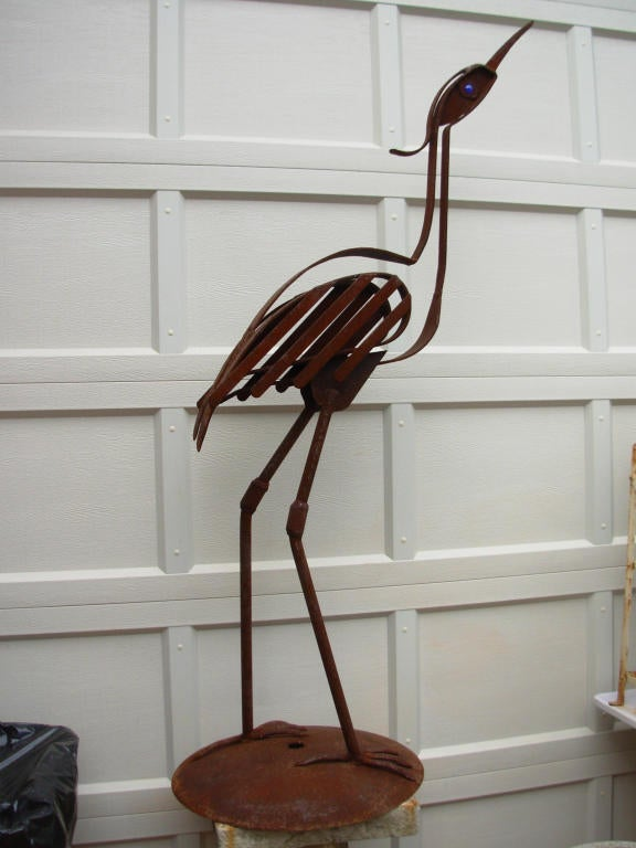 This wrought iron bird figure is by Robert Cumpston who studied welding under Calder, & exhibited his sculptures at the vetted crafts fair sponsored by the then American Craft Museum of NYC, it is approx 6 ft tall, Cumpston lived in Colfax Ill & was