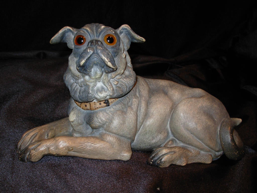 A wonderful terra cotta dog, with glass eyes, and floppy years, from a collection of terra cotta dogs The dog has no breaks or repairs, by Goldscheider.
