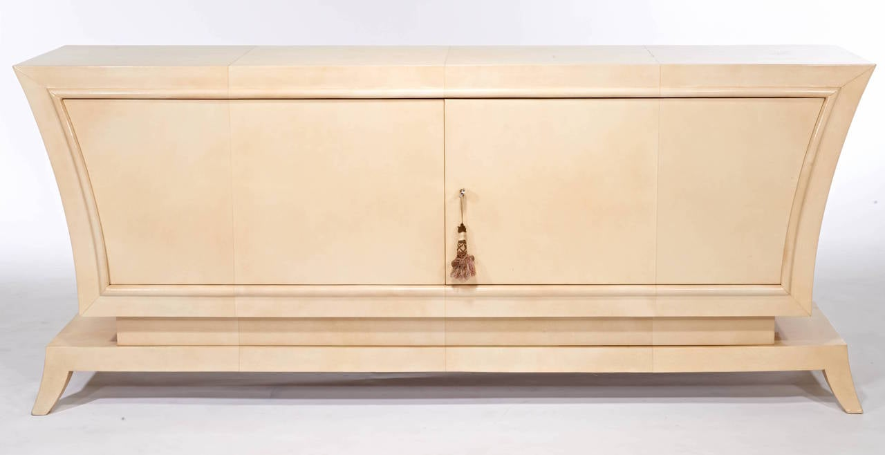 A gorgeous Jean Pascaud cabinet completely clad in parchment with a fitted sycamore interior.