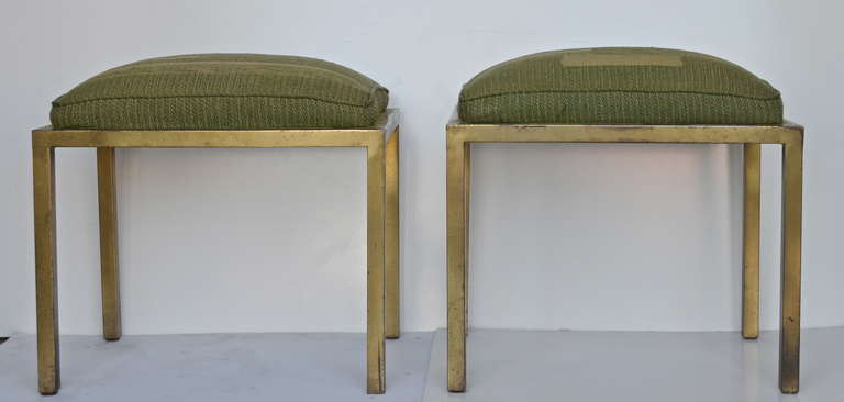 A pair of gilded iron stools by Marc DuPlantier with original moderne upholstery. Provenance-Christies, New York.