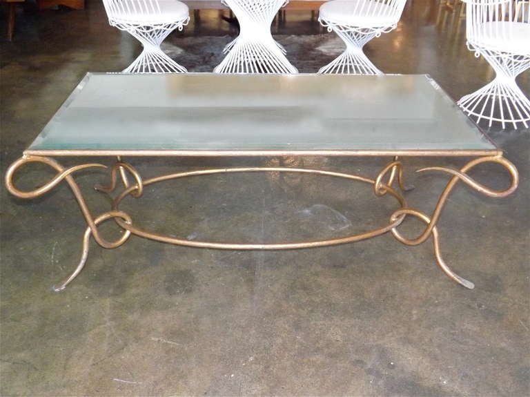 René Drouet gilded cocktail table with oxidized mirror top. Stunning.