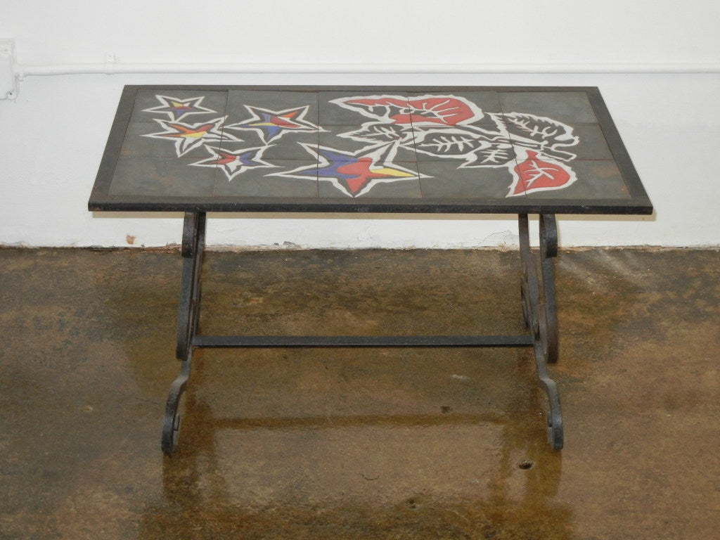 Jean lurcat tile top table for sale at 1stdibs this is a gorgeous hand painted ceramic tile table in wrought iron base dailygadgetfo Image collections