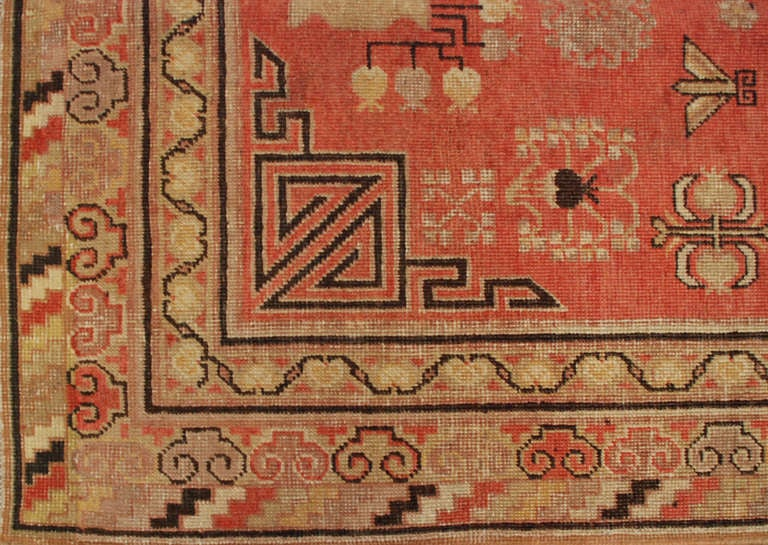 An antique Central Asian Samarkand rug with beautiful pomegranate medallion amidst a field of floral and fruit motifs, surrounded by multiple complementary borders.  Measures: 4' x 7'10