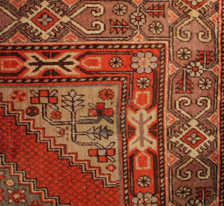 An early 20th century Central Asian Samarkand rug with an intricate double-diamond design with densely woven flower fields, surrounded by multiple contrasting borders.  Measures: 5'8