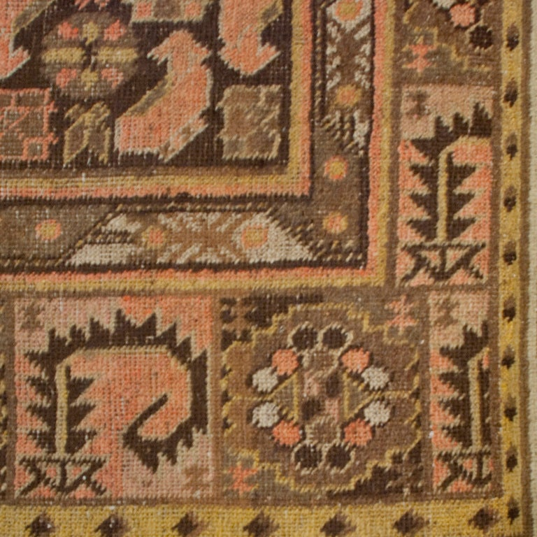 A 19th century Central Asian Khotan carpet with three central octagonal medallions surrounded by a field of stylized shrimp motifs with an alternating floral and shrimp border.    Measures: 5'3