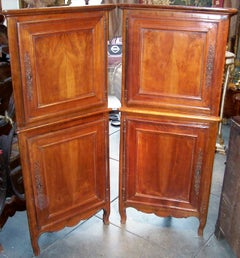 Pair of French Louis XV Provincial Walnut Petit Corner Cupboards or Cabinets