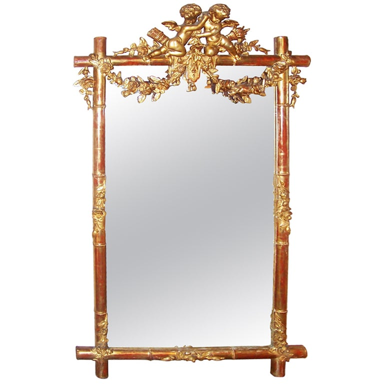 Giltwood Faux Bamboo Mirror with Cherubs or Putti Crest with Floral Garlands For Sale