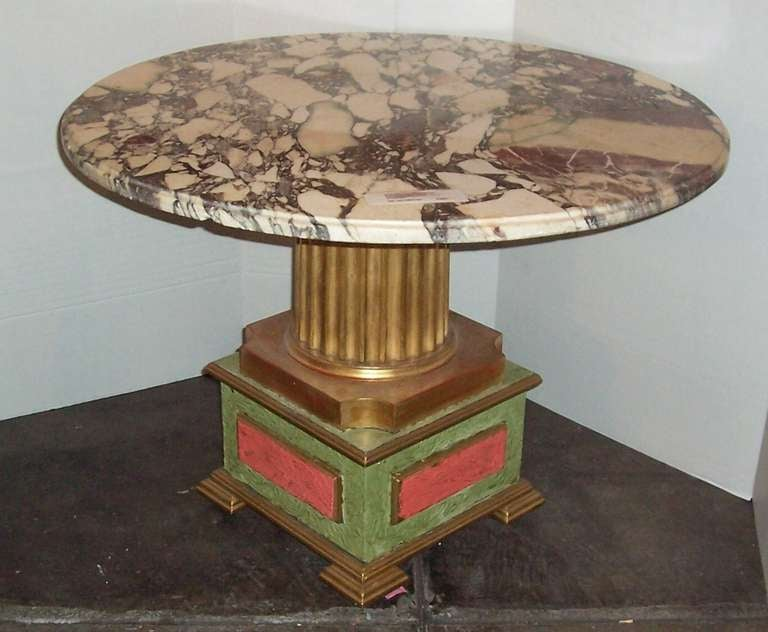 Constructed with some antique parts .The fluted gilt shaft and its base probably late 19th century as is the very colorful marble top. The bottom squared base with coral and green faux definitely 20th century . Additional support under the marble