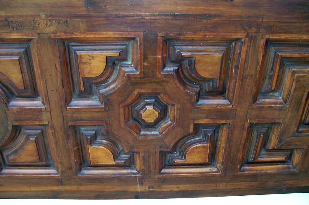 A walnut and fruitwood Tuscan door , later converted to a king bed (or Queen bed given current trend to oversize ) size headboard with old massive rings and chain . Unique geometric patterns. Nice old luster / patina  and contrasting warm cognac