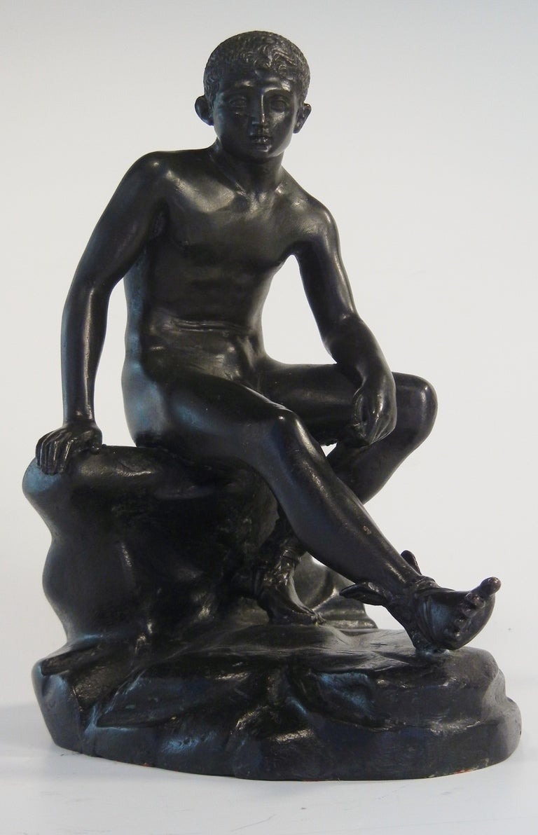 A 19th century bronze figure of the seated Mercury after the antique, being a souvenir of the Grand Tour of Europe. It has crisp lines and clean casting, a pleasing black patina and fine workmanship. It is unsigned but is probably from Naples, and