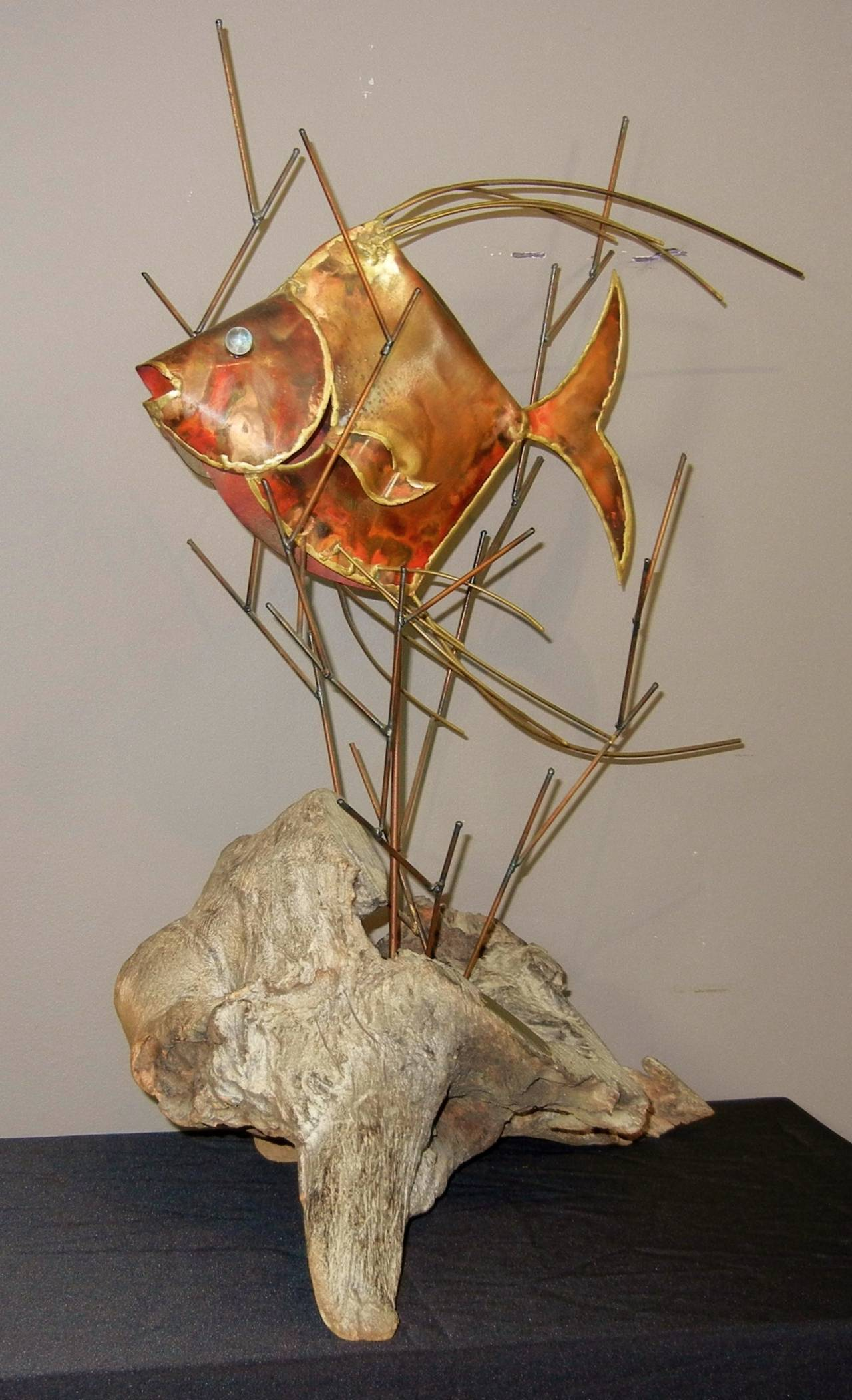 This fine midcentury hollow fish sculpture is by New York State artist Alex Kovacs in cooper, steel and driftwood in the Brutalist manner. It is signed and dated in a plaque