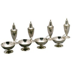 Set of Four Tiffany & Co. Pepper Shakers, Salt Cellars & Spoons.