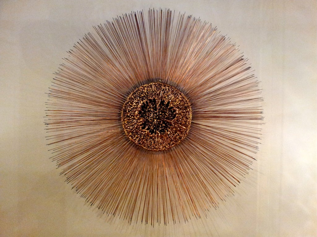 Colossal sunburst wall sculpture by Curtis Jere. Nicely executed all around, its center is formed of irregularly melted mixed metals copper, bronze, brass, w/ double layered copper rods. At almost 4 feet in diameter this is surely a one of a kind.