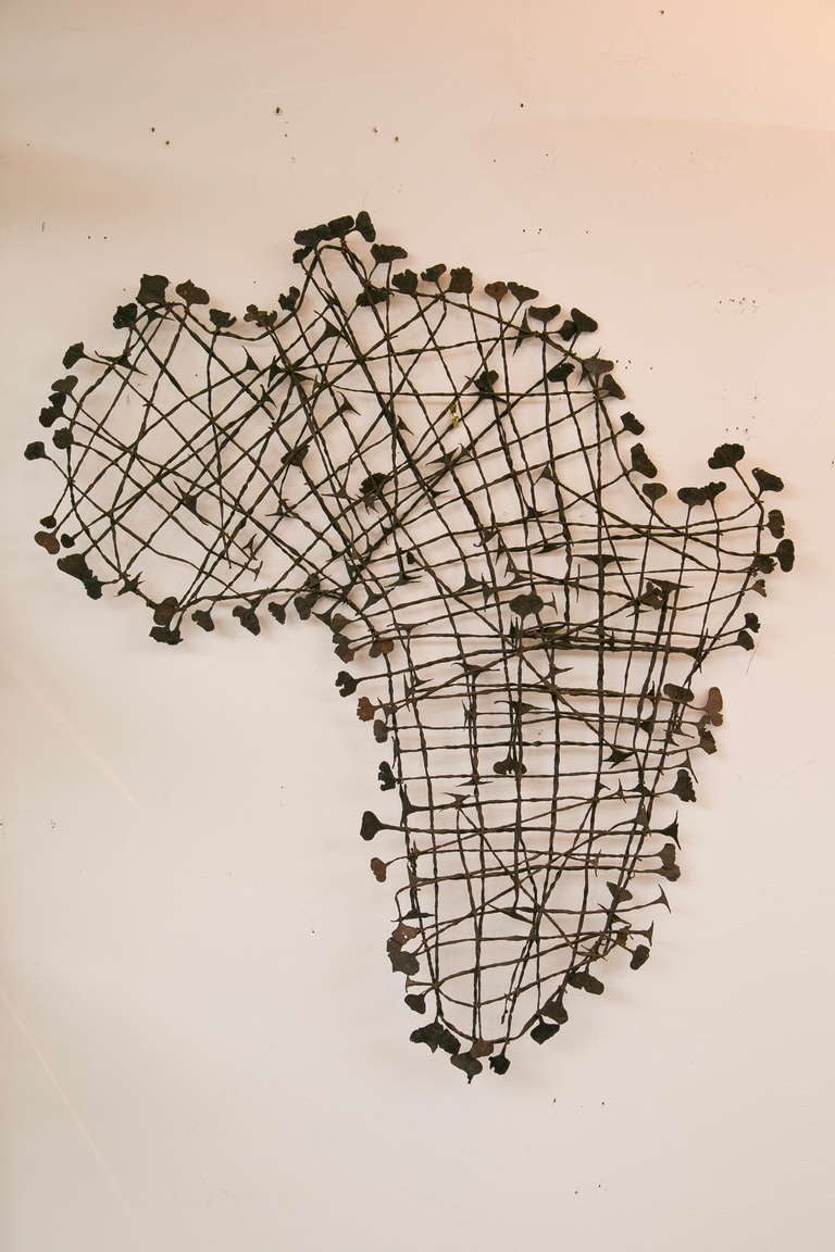 Vintage hand-fashioned twisted iron representation of the African  continent.