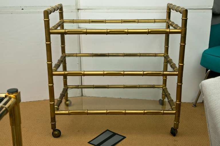 A late 1950's early 1960's 3 tier, faux-bamboo bar cart with gilt finish. All original.