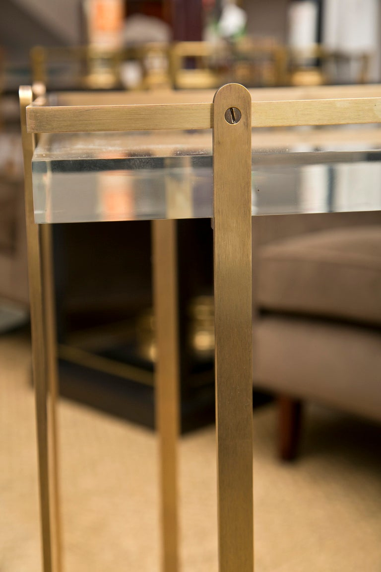 Unusual brass framed bar cart on castors with 2 1.25