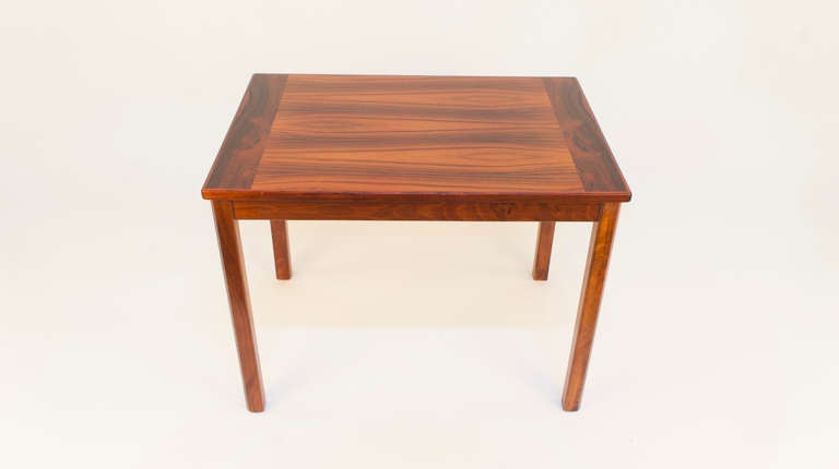 Nearly identical in size to the previous entry, yet unique in the cabinetmaker's use of lighter, more even-grained wood veneers, these tables look like fraternal, rather than identical twins. 