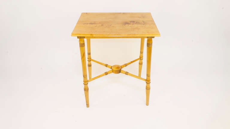 Created from solid birch, with turned legs and spindled stretchers, and designed for a casual meal for two, the table is slightly lower (1.75