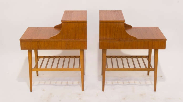 Constructed of teak with lots of storage options: a single long drawer, a full sized lower latticed shelf, a working surface and a shallow upper shelf. A perfect pair of tables for the person, who reads, eats and enjoys his morning beverage in bed!