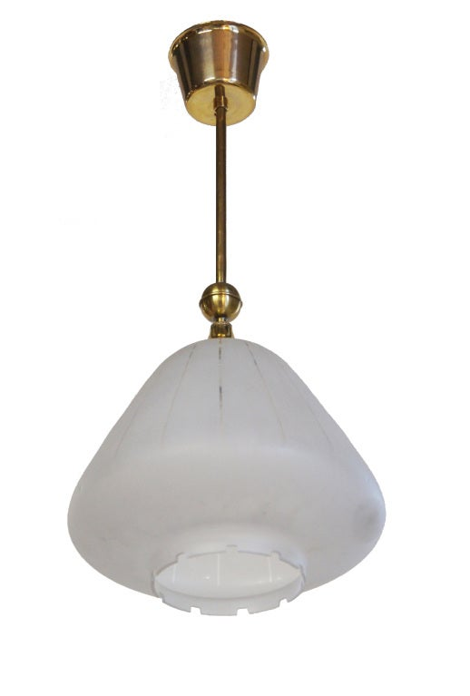 A petite down facing fixture of frosted glass, etched with clear vertical lines and a stylized dental motif edge.