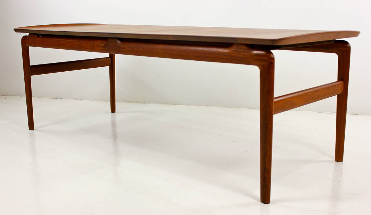 Solid teak danish modern coffee table designed by peter hvidt at 1stdibs Modern teak coffee table