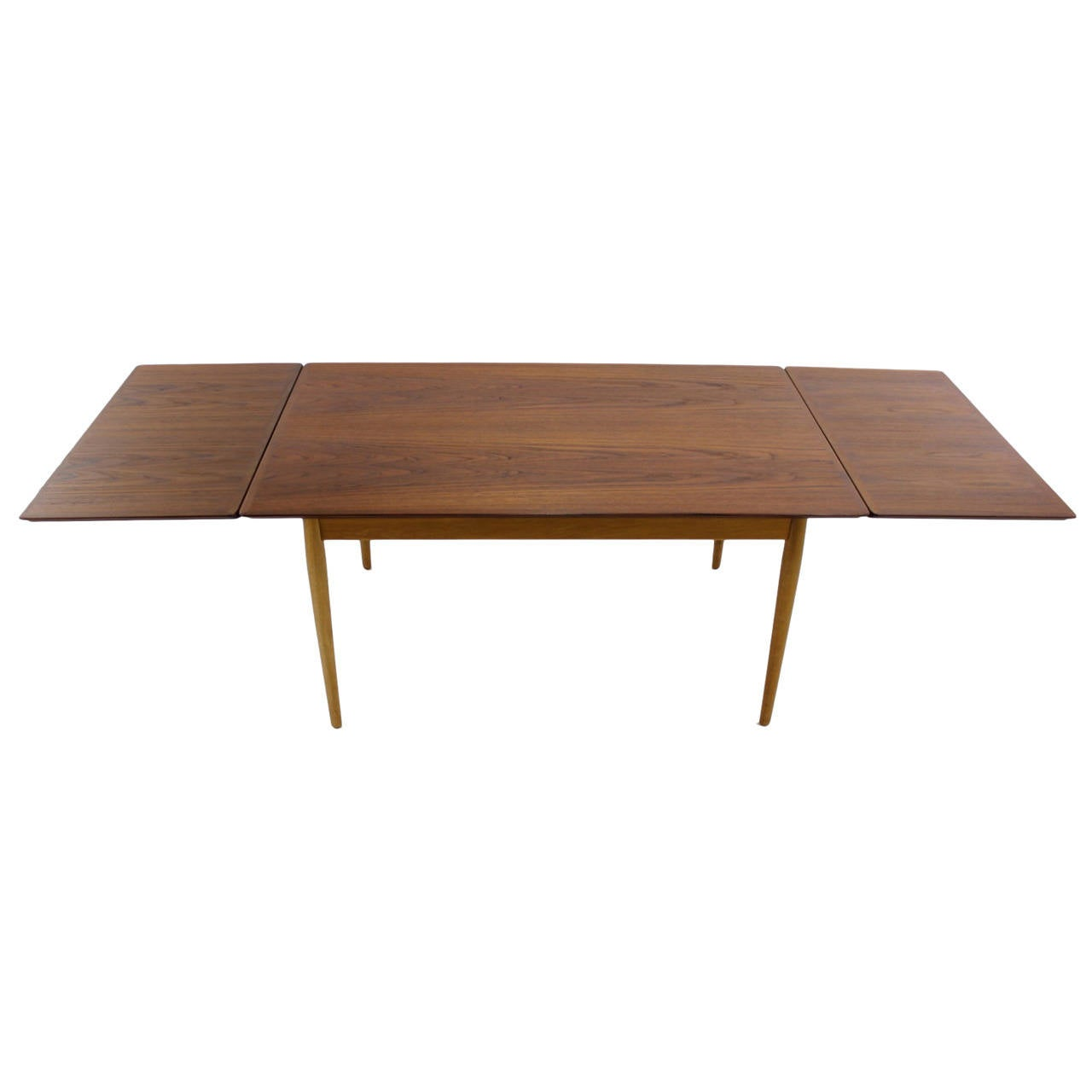 Danish modern teak and oak dining table designed by arne for Danish modern dining room table