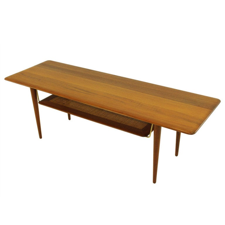 solid teak danish modern coffee table designed by peter hvidt at