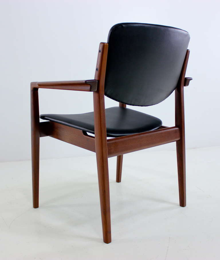 pair of danish modern teak arm side chairs designed by finn juhl at