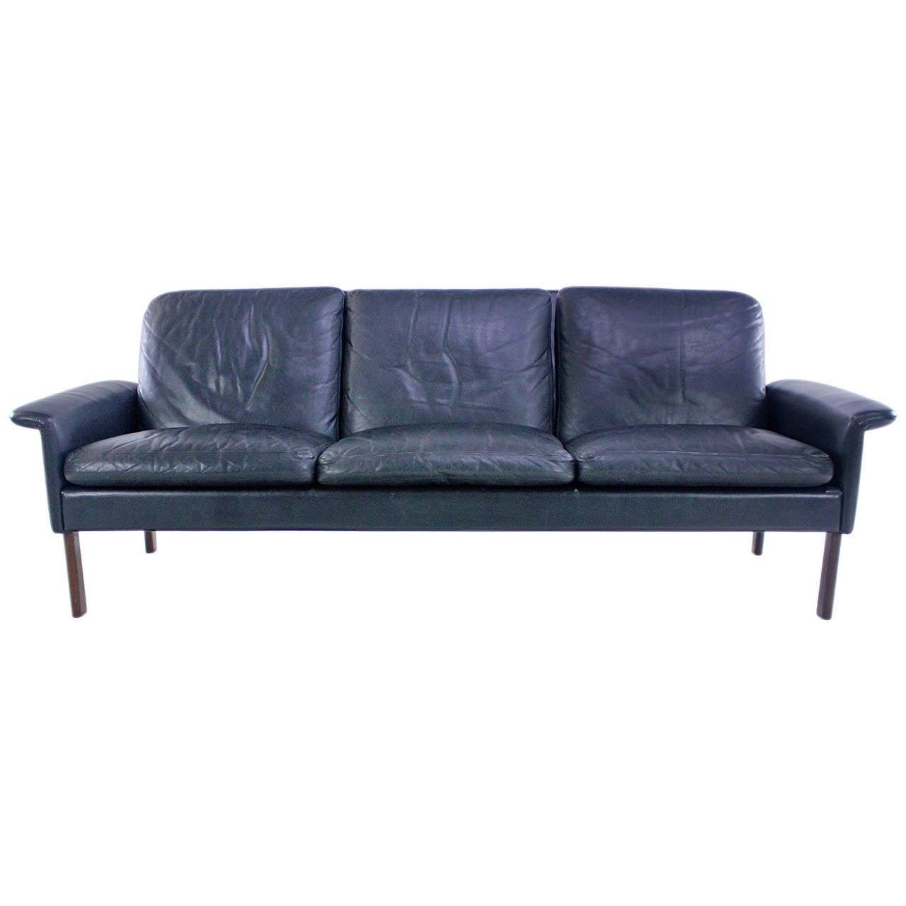 classic danish modern three place black leather sofa at