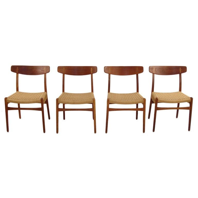 Four danish modern teak and oak dining chairs by hans wegner at 1stdibs - Scandinavian teak dining room furniture design ...