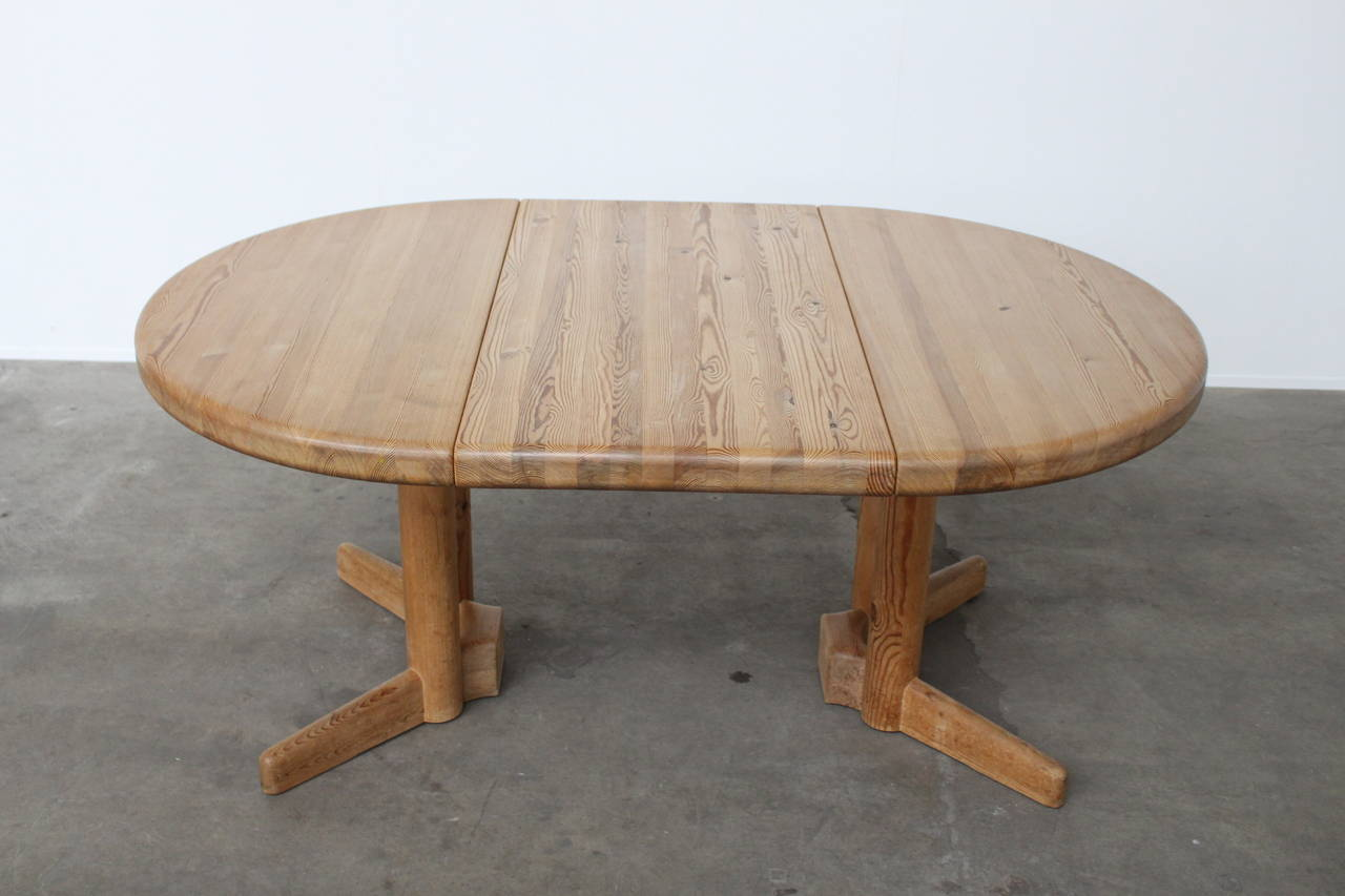 Beautiful extendable dining table in pine by Rainer Daumiller for Hirtshals Sawmill, Denmark. With a sliding system you can go from a round to an oval table. These solid pine designs from Daumiller do have a great match with those by Charlotte