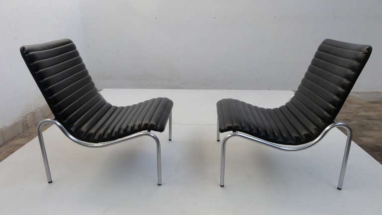 A stunning pair of 703 lounge chairs by designer Kho Liang ie made by manufacturer STABIN in Woerden Holland.  STABIN was a steel construction company who produced interiors for busses and trains in the 1960's.  When they acquired a new machine that