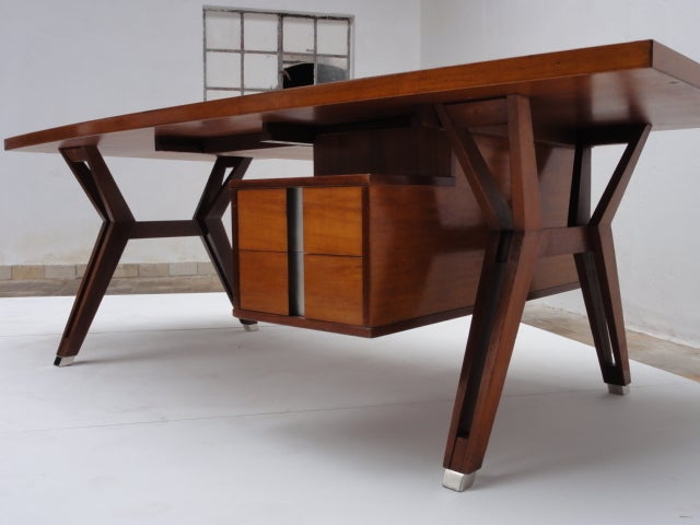 A stunning ''Terni'' executive desk designed by Ico Parisi in 1958 for MIM (Mobili Italiani Moderni) Rome, Italy. The standard production Terni desk was provided with a rectangular top but a rare version with a curved profile cut into the front edge