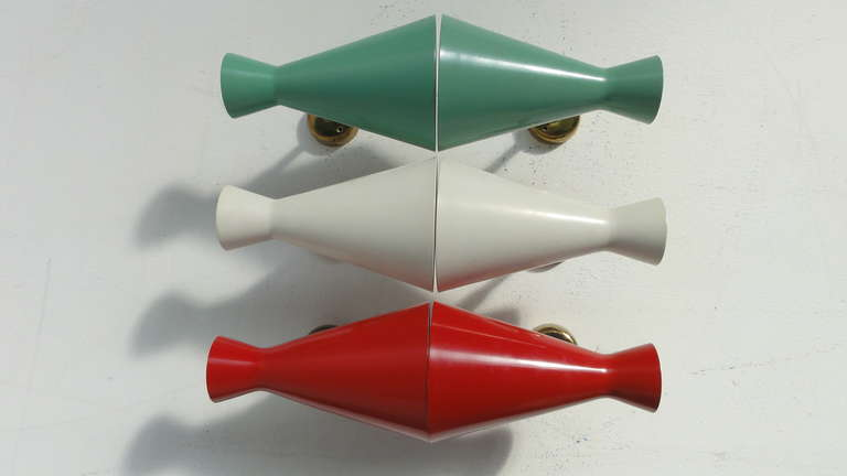 A really nice big set of 50's Italian wall sconces   The colors are similar to the Italian flag and the sconces are adjustable in angle and can be rotated.