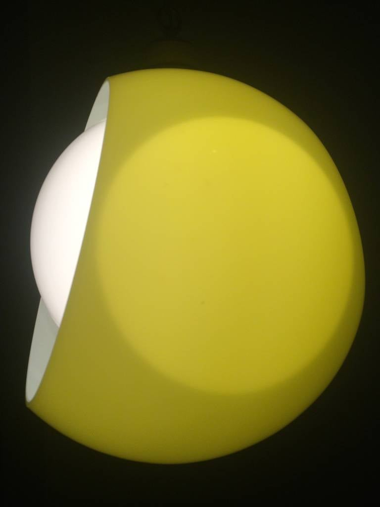 Stunning Space Age Italian Murano opaline and bright yellow glass Eclisse hanging pendant by Carlo Nason for Mazzega from the 1960s  Both reflectors can be rotated in all direction to adjust the amount of light emitted  The idea is based on a