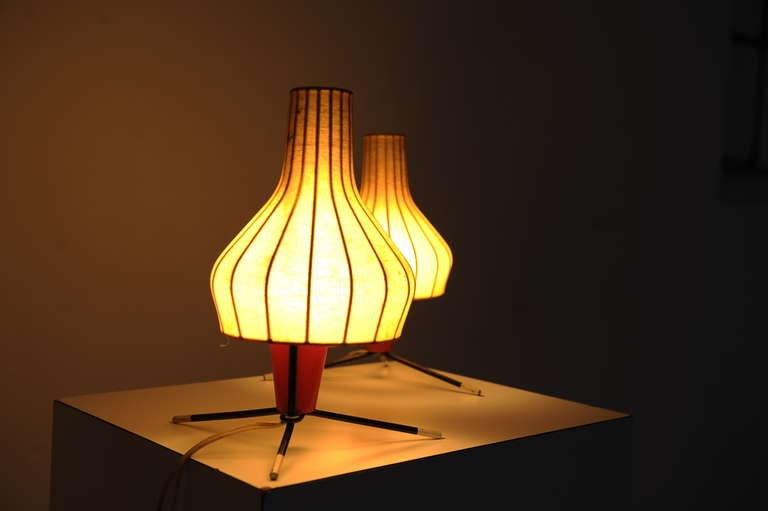 A cute pair of table lamps in all original condition.  Produced in Switzerland by BAG TURGI.  The lamps maintain their original sprayed fibre over metal shades, 3 small damages as can be seen on images 8,9 and 10  The tripod base has 3 typical
