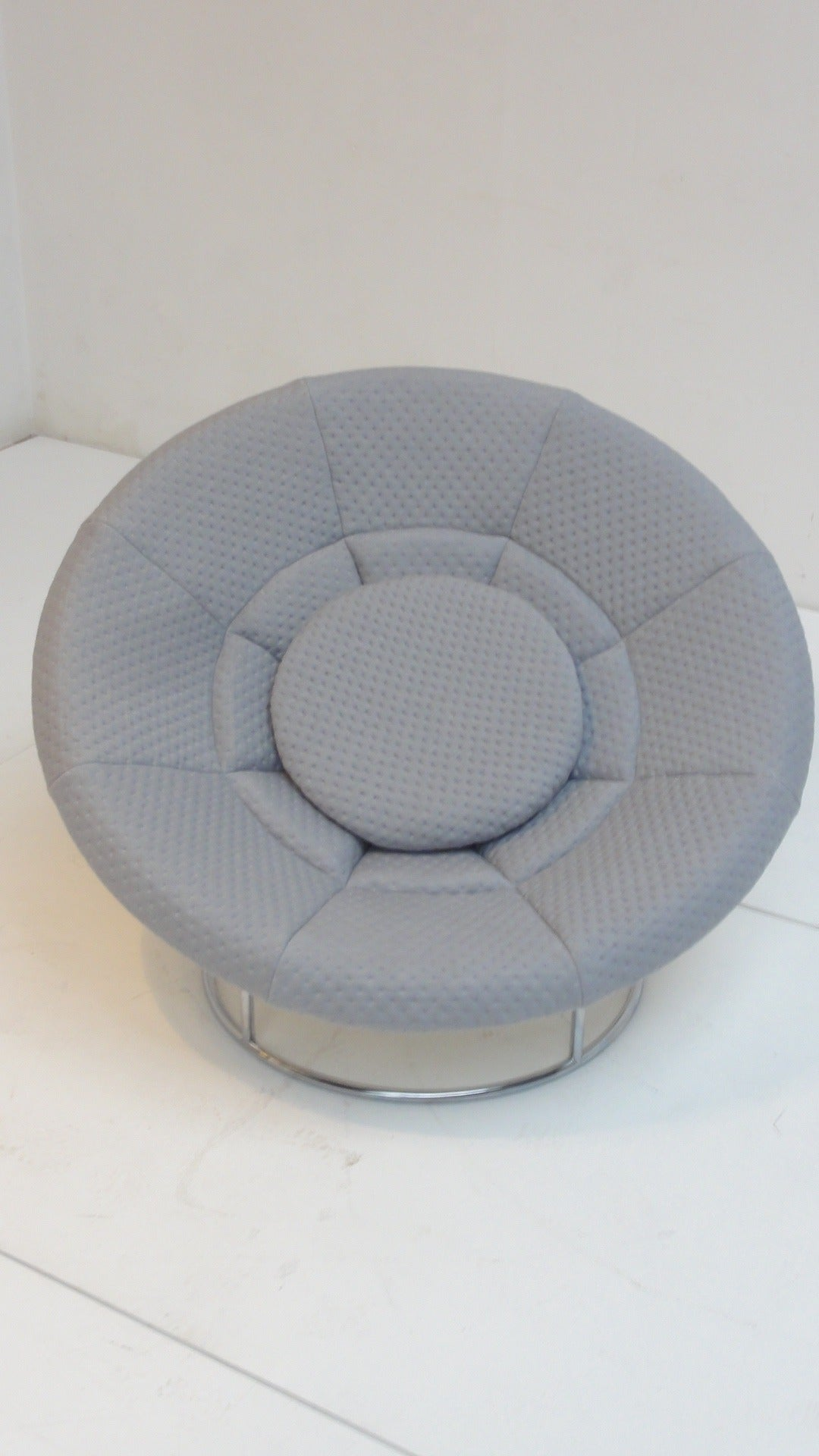A true 1970s flower power lounge chair in the style of Verner Panton's Peacock chair.  The half globe white fiberglass shell is upholstered with new