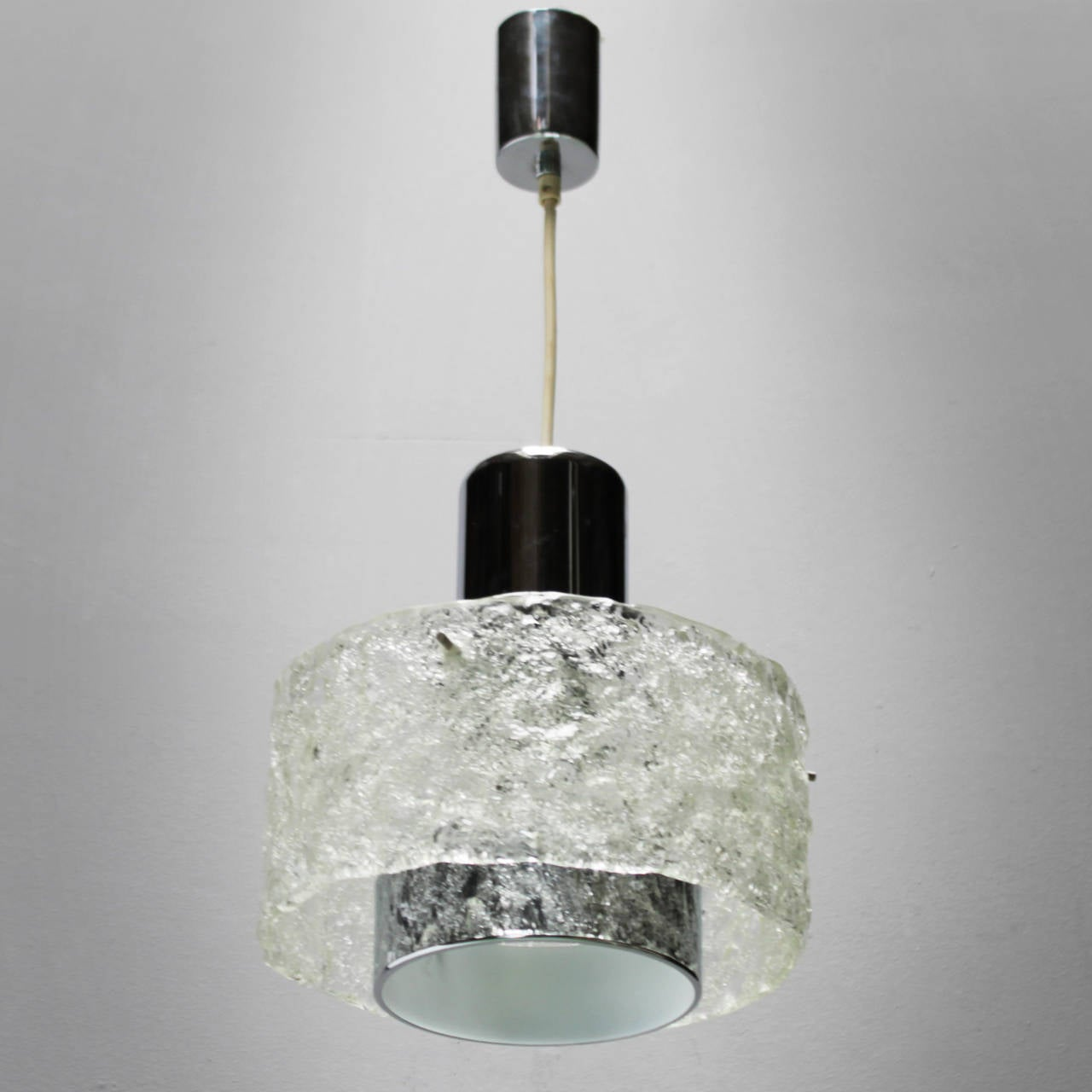 Pendant in the style of Kalmar. Frosted 'ice' glass and chrome.