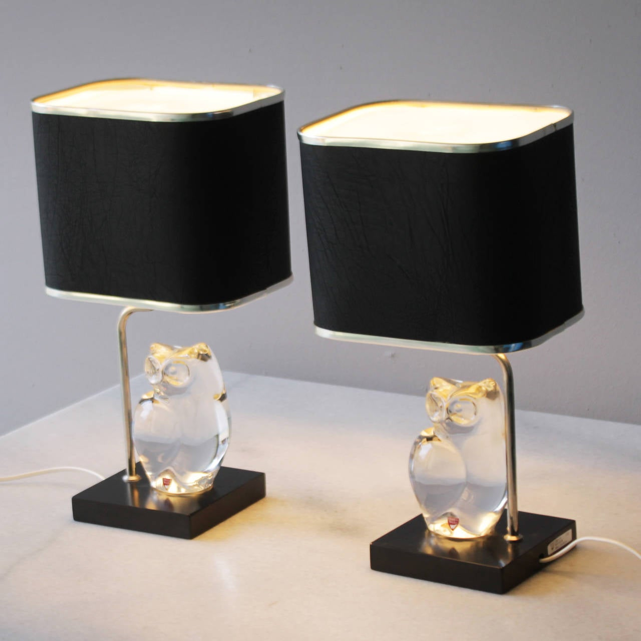 Set of table lamps with beautiful crystal owls by Olle Alberius for Orrefors Sweden. Black faux leather shades, but maybe it's real leather, I'm not sure can't see or feel the difference. Acrylic diffuser on top of the shades. The lamps are marked