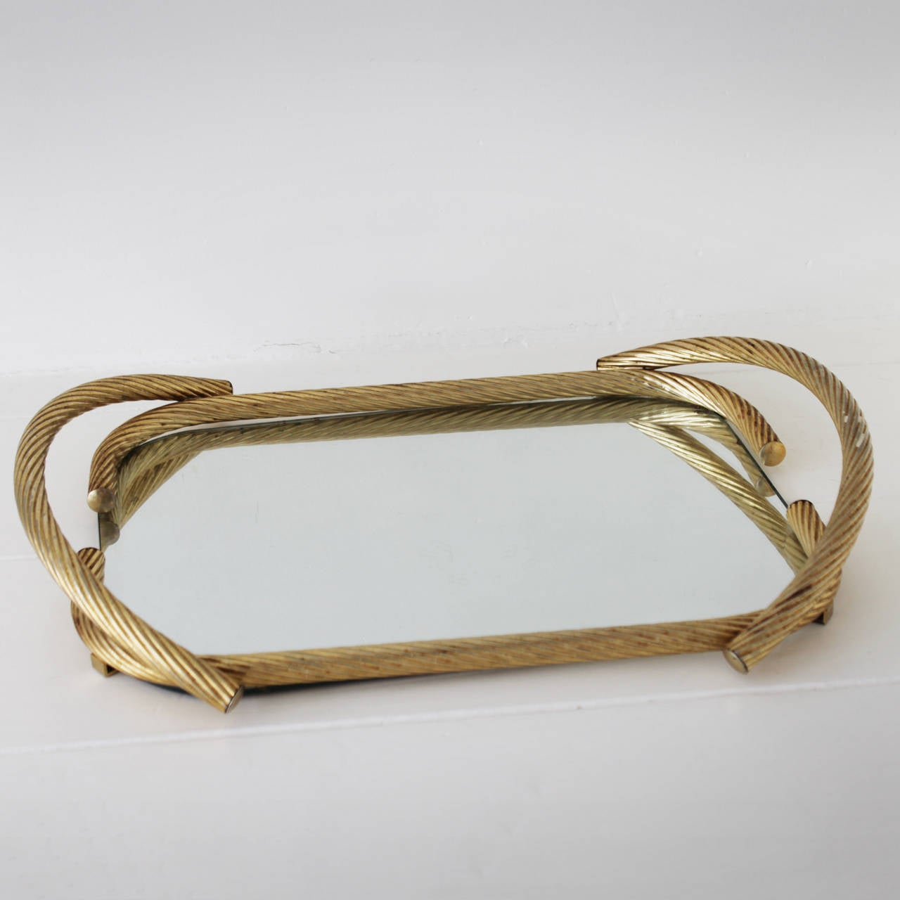 Rope mirror serving tray from France. Gilded metal. Measurements: height 3.5 in. (9 cm), length 21.6 in. (55 cm), width 15.7 inches (40 cm).