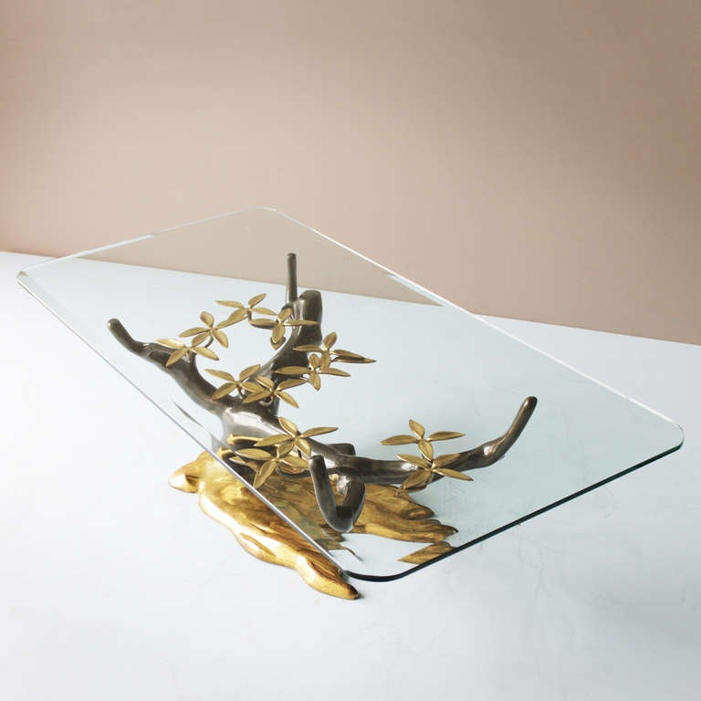Brass and gilded coffee table by Willy Daro, Belgium. Beveled glass top. Measurements: height 16.5 in. (41 cm), depth 23.6 in. (60 cm), length 47.2 inches (120 cm).