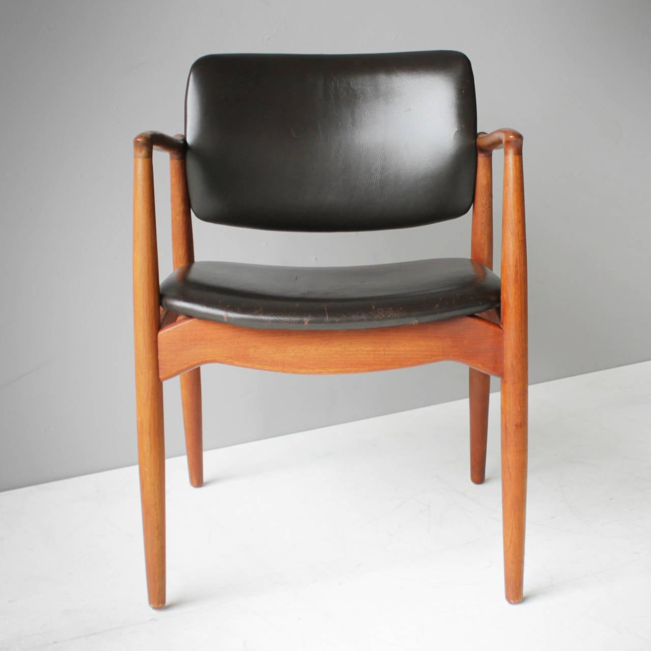 'Captain's Chair' by Eric Buck for Ørum Møbler, Denmark. Marked. Dark brown leather and teak. In a beautiful vintage condition.