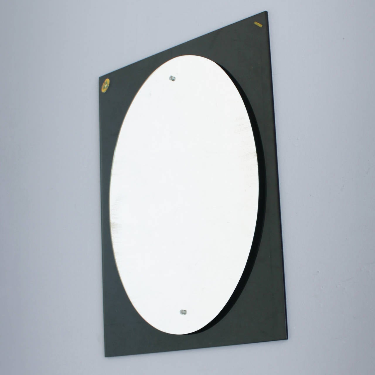 Typical Italian mirror from the 1950s. Though the mirror is marked with a Caprotti sticker, this Monza based company is rather a retailer than a manufacturer. Already in the 1950s the shop was selling products of brands like Arteluce, Arredoluce and