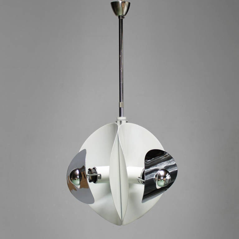 Set of three Italian mirror pendants by Brevettato. White lacquered metal and chrome. One with three bulbs and the other two with each five-light bulbs. Dimensions small one with the three bulbs: height ceiling till drop 23.6 in. (60 cm), diameter
