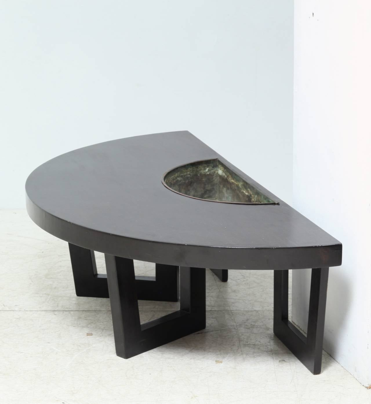 A Black Wooden Semicircular Coffee Table With Removable Copper Planter Inserted This Is