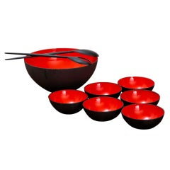 Black and red Krenit salad bowls with serving spoons